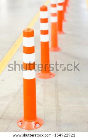 Orange Bollard inside car park  - stock photo