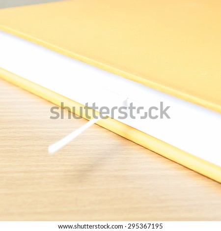 orange book on wood table background