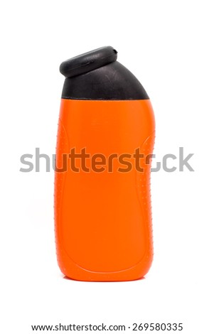 Orange  bottles with black cap isolated on white background. - stock photo