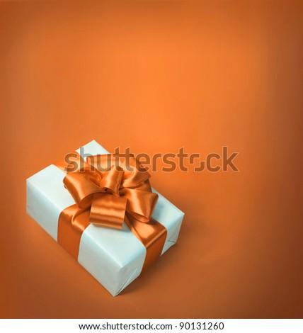 orange bow and white box - stock photo