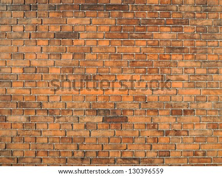 Orange brick wall texture - stock photo