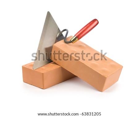 orange bricks with trowel - stock photo