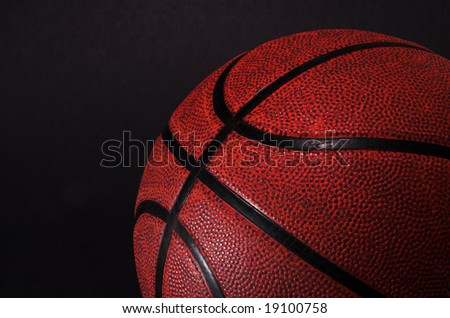 Orange Brown basketball on a black background