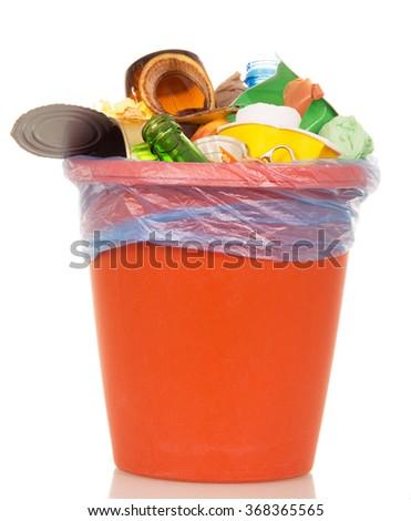 Orange bucket with household waste isolated on white background - stock photo
