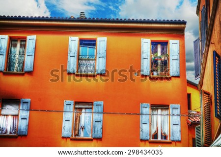 orange building under a cloudy sky in Bologna, Italy - stock photo