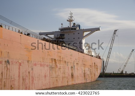 Orange bulk ore carrier - stock photo