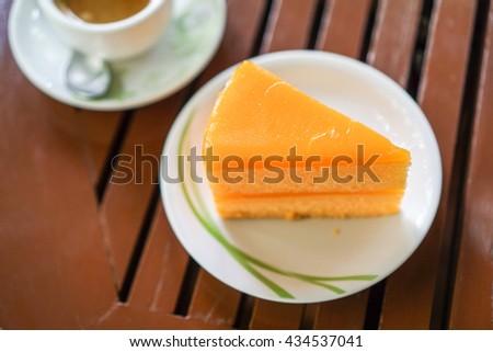 Orange Cake on wood table and coffee background  - stock photo