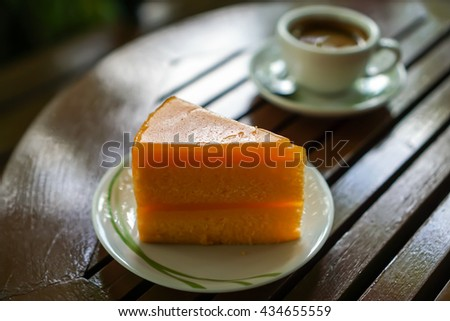 Orange Cake on wood table and coffee background in coffee shop  - stock photo