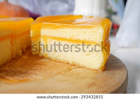 Orange Cake on Wooden Plate