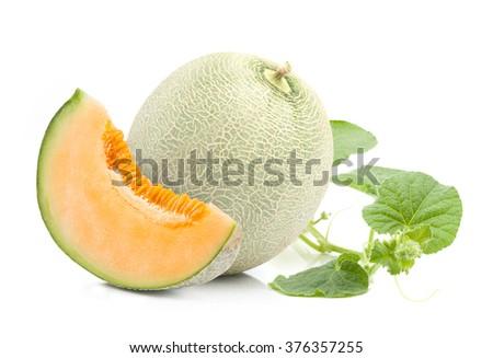 Orange cantaloupe melon  and leaves on isolated on white - stock photo