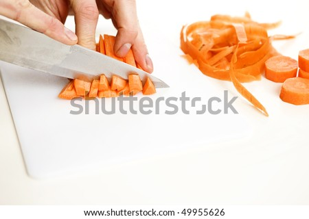 orange carrot been slided and diced in a kitchen