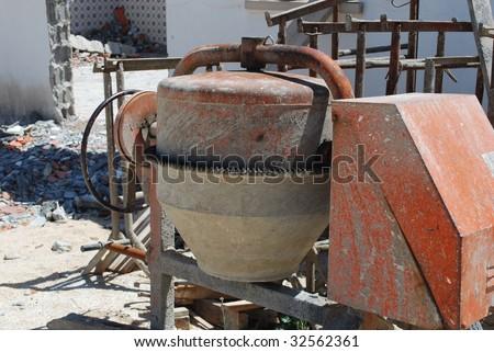 orange cement mixer at a construction site - stock photo
