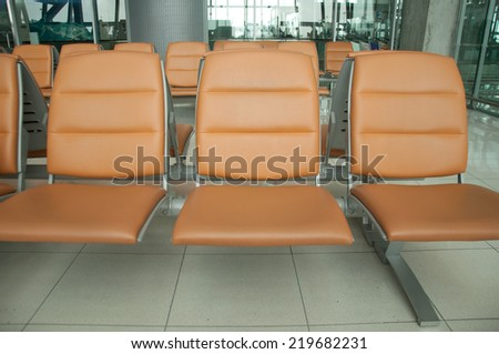 orange chair at airport - stock photo