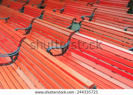 Orange chairs in a row - stock photo