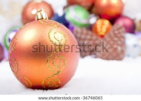 Orange Christmas Ornament  On fake (Artificial) Snow