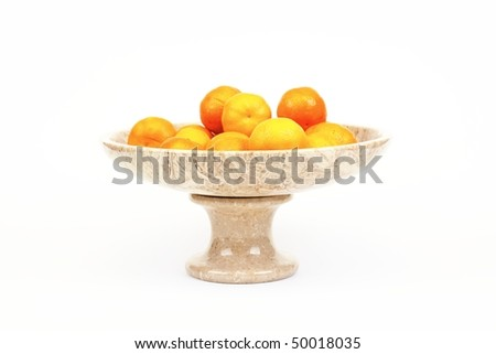 Orange citrus fruit in a stone bowl