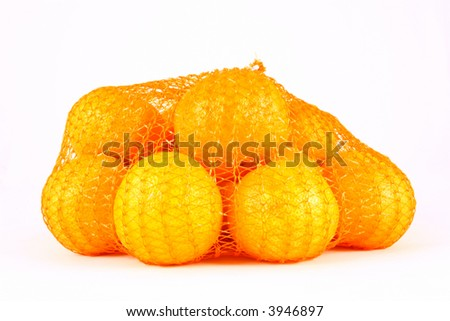 orange Clementines in a netted bag and box - stock photo