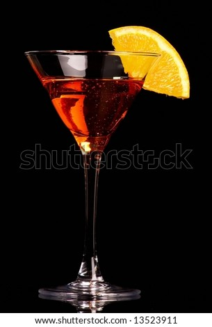 Orange cocktail on black background - stock photo