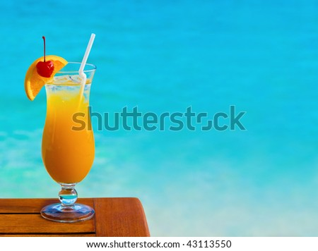 Orange cocktail on table and sea background - stock photo