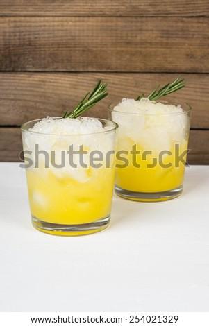 Orange cocktail with rosemary - stock photo