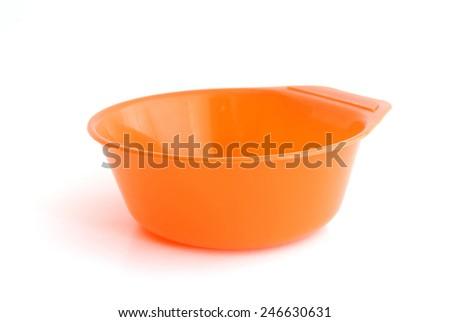 orange color plastic bowl - stock photo