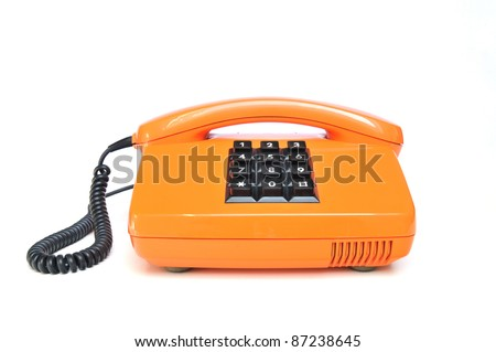 Orange colored vintage telephone with phone keypad and receiver on white background - stock photo
