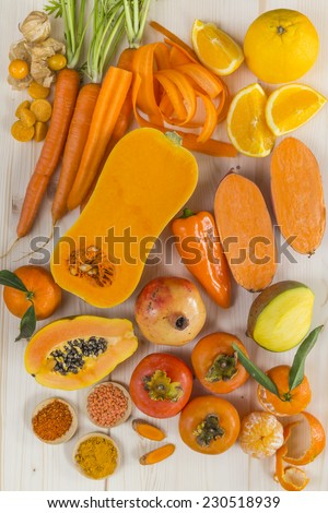 Orange coloured fruit and vegetables - stock photo