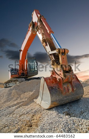 Orange coloured heavy construction digger - stock photo