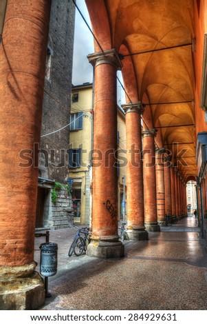 orange columns in Bologna, Italy - stock photo