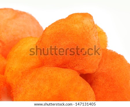 Orange cotton candy over white background - stock photo
