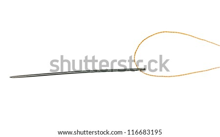 Orange cotton thread pushed through eye of needle for sewing - stock photo