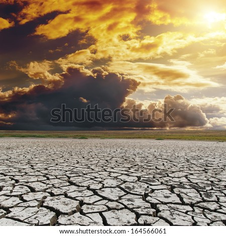 orange dark sunset over drought earth. global warming - stock photo