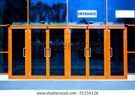 orange doors of modern trade center - stock photo