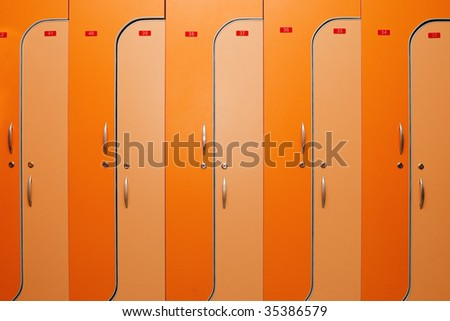 Orange dors of lockers witn nombers - stock photo