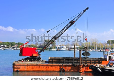 orange dredging platform outside harbor - stock photo