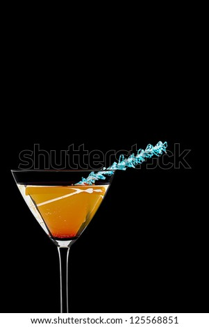 Orange drink in martini glass isolated on black - stock photo