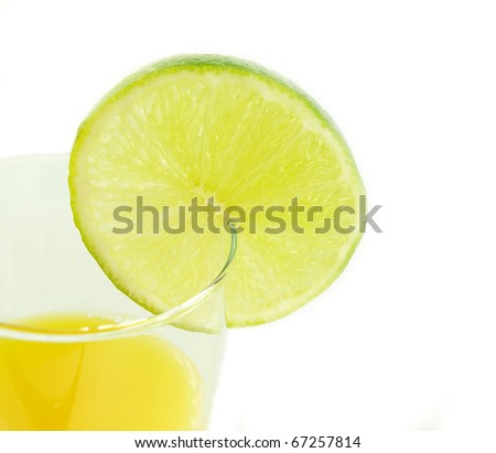 Orange drink with lime isolated on white background - stock photo