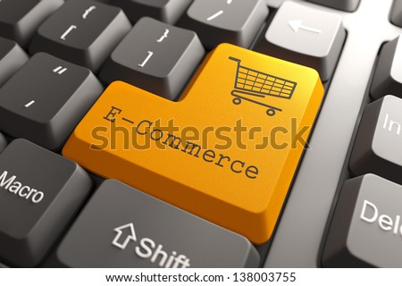 Orange E-Commerce Button on Computer Keyboard. Internet Concept. - stock photo