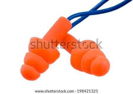 Orange ear plugs on white background - stock photo