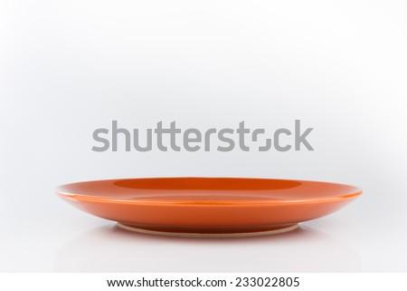 Orange empty plate. Isolated on white background - stock photo