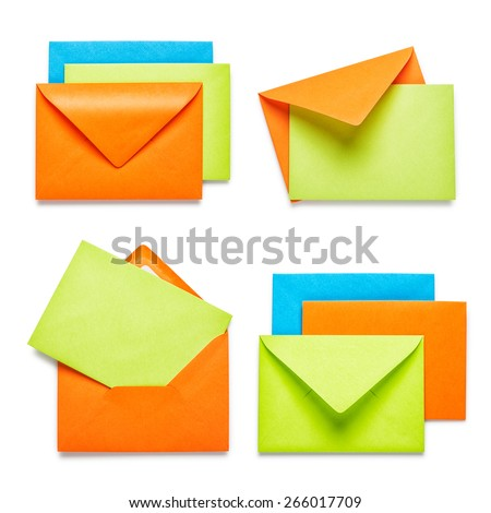Orange envelopes with green card collection isolated on white background - stock photo