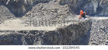 Orange excavator on a working platform. Panorama landscape - stock photo