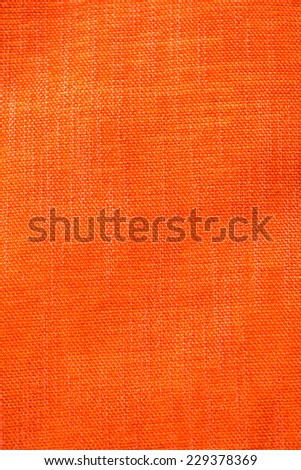 Orange fabric background  - stock photo