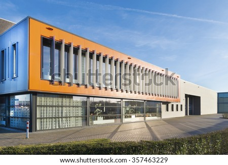 orange facade of a modern office building in the netherlands - stock photo
