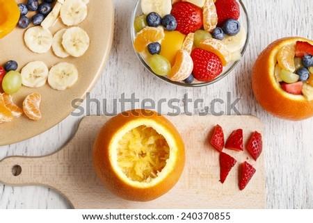 Orange filled with fruit salad - stock photo