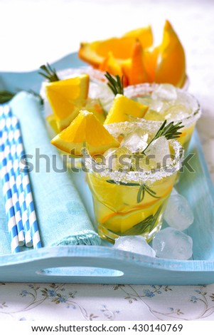Orange fizz in a glass on turquoise background. - stock photo