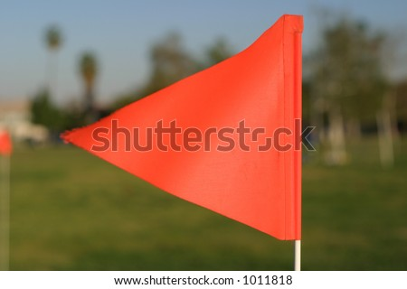 Orange flag on field - stock photo