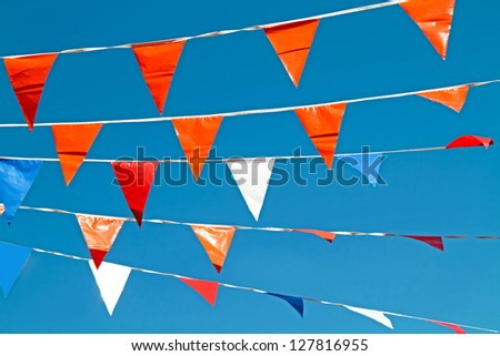 Orange flags, celebrating queens day in the Netherlands - stock photo