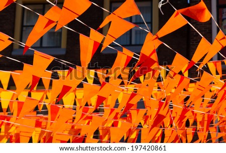 Orange flags during soccer world cup 2014. Flags and color also used at kings day in Holland. - stock photo