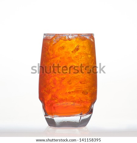 Orange flavor aerated soft drinks whit soda and ice in glass isolated on white background - stock photo
